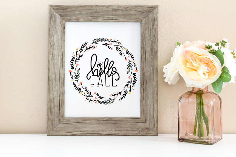 Oh Hello Fall print in a frame with pink flowers