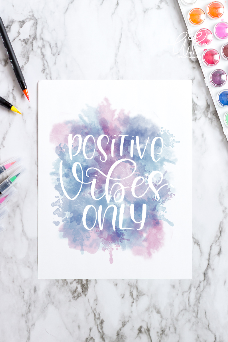 positive vibes only over pink and blue watercolor background