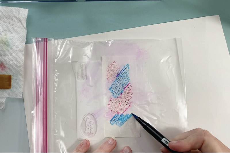 color on a plastic bag to make watercolor art