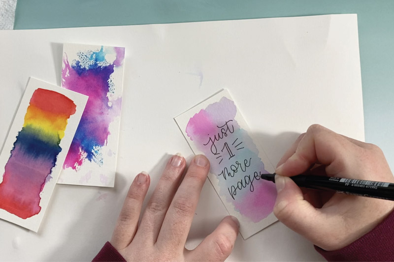letter over watercolor bookmark designs