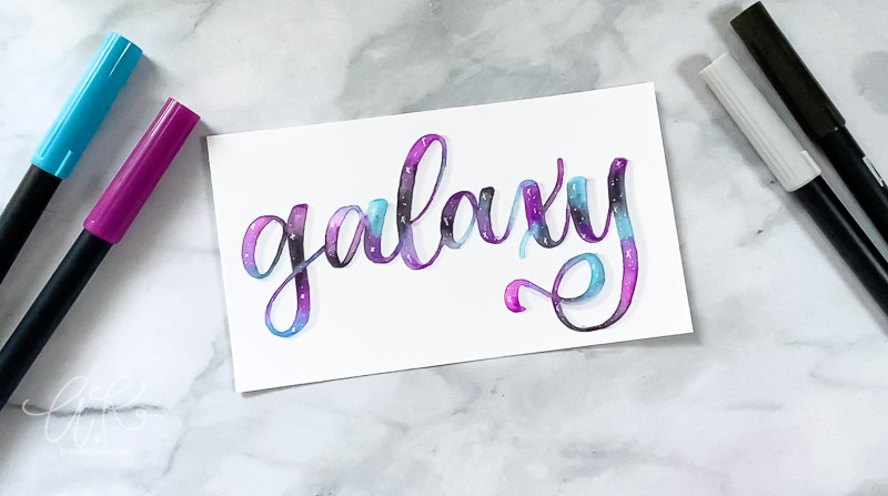galaxy written in modern calligraphy with blues purples and black hues blended together