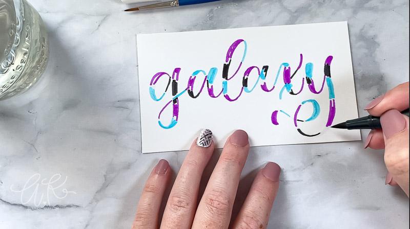 black color placed randomly over galaxy words