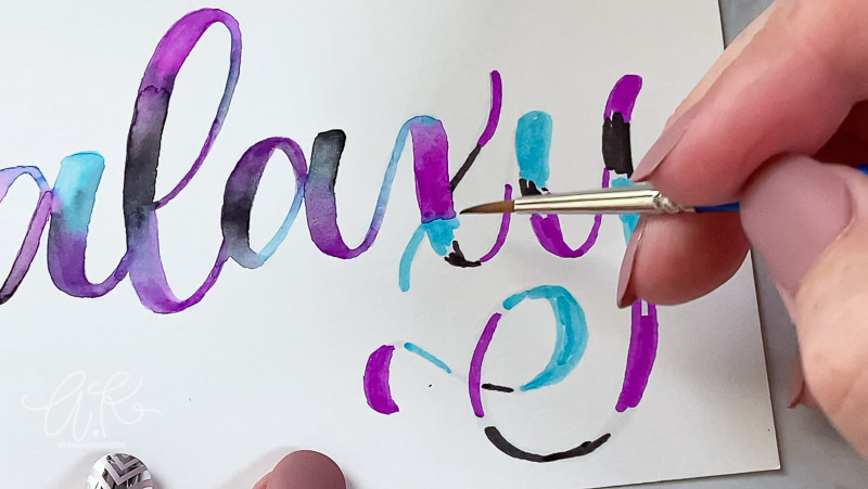 """close up blending of galaxy colors together with a brush on letter """"x"""""""