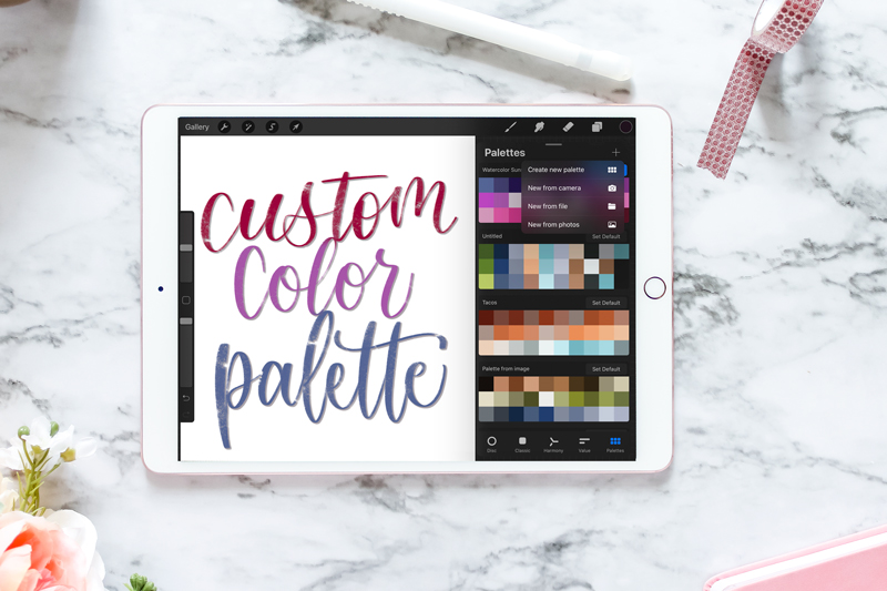 ipad mockup showing new color palette in Procreate, on a marble backdrop