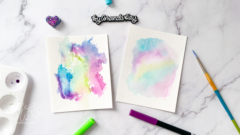 Watercolor backgrounds flat lay image with Tombow markers