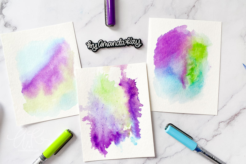 three watercolor backgrounds flat lay