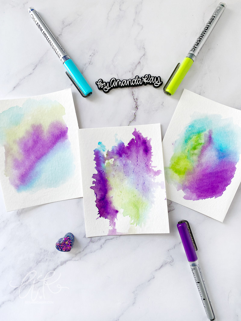 watercolor paintings with karin markers flat lay